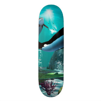 Underwater world with funny playing orcas skate board decks