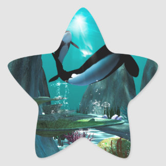 Underwater world with funny playing orcas, star sticker