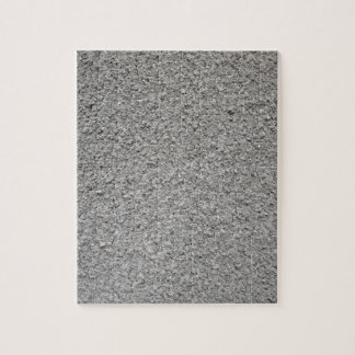 Uneven surface of the gray cement puzzles
