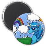 Unicornio azul que vuela con el arco iris imán