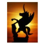 Unicornio de la puesta del sol postal