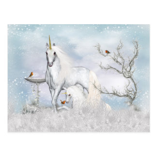 Unicornio del invierno de la fantasía y postal del