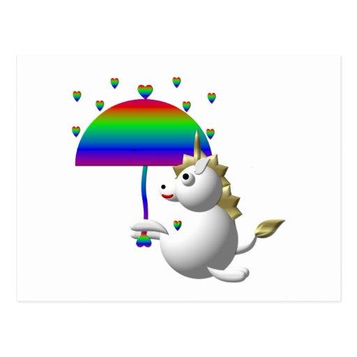 Unicornio lindo con un paraguas postales