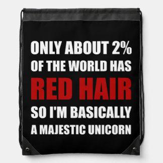 Unicornio majestuoso del pelo rojo mochila