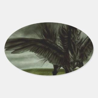 Unicornio negro en campo abierto pegatina ovalada