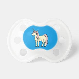Unicornio poner crema con la melena rosa clara chupete de bebé