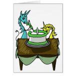 Unicornios que hielan una torta tarjeta de felicitación
