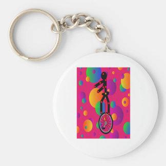 Unicycle fantástico en el circo con el fondo llaveros personalizados