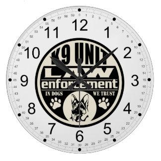 Unidad K9 en perros que confiamos en (el negro) Reloj Redondo Grande