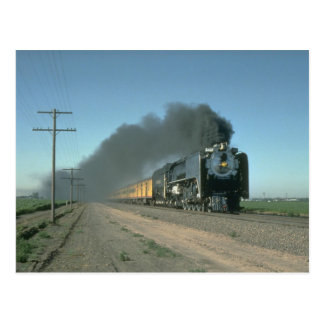 Union Pacific No. 8444 powers a train from Denver Postcard