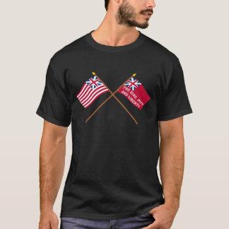 Unión y banderas magníficas cruzadas de la playera