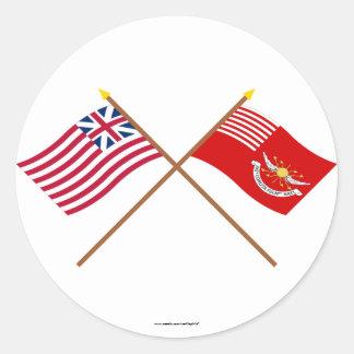 Unión y banderas magníficas cruzadas de los etiquetas redondas