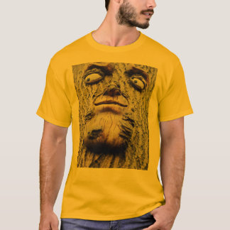 Unique face carving on tree makes great tee
