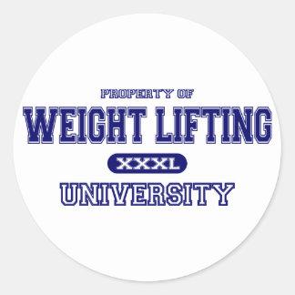 Universidad del levantamiento de pesas etiqueta redonda