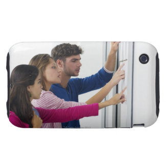 University students checking bulletin board for iPhone 3 tough covers