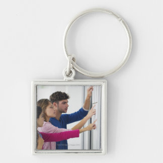 University students checking bulletin board for keychain