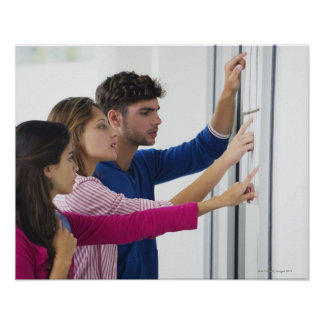University students checking bulletin board for poster