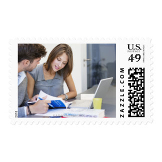 University students using laptop in classroom stamps