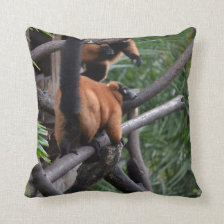 Unsuspecting Red ruffed lemur on branch Throw Pillow