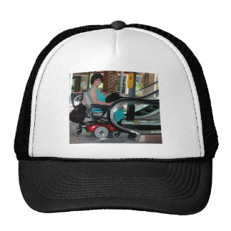 UP THE DOWN ESCALATOR IN A POWERCHAIR TRUCKER HAT