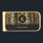 """Upscale Gold &amp; Black Floral Damask Gold Finish Money Clip<br><div class=""""desc"""">Money Clip. Featuring an Upscale Gold &amp; Black Floral Damask Design. 100% Customizable. Ready to Fill in the box(es) or Click on the CUSTOMIZE button to add, move, delete, resize or change any of the font or graphics. Made with high resolution vector and/or digital graphics for a professional print. NOTE:...</div>"""