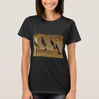 Upside down people with right side up shadows T-Shirt