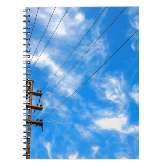 Upward view on power lines and electric pole notebook