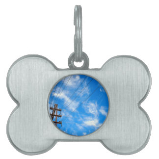 Upward view on power lines and electric pole pet ID tag