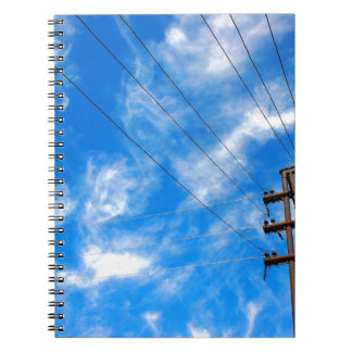 Upward view on power lines and electric pole spiral notebook