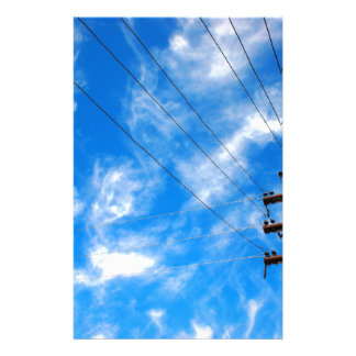 Upward view on power lines and electric pole stationery