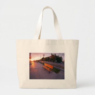 Urban cityscape with benches and lanterns in the e large tote bag