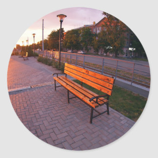 Urban cityscape with benches and lanterns in the e classic round sticker