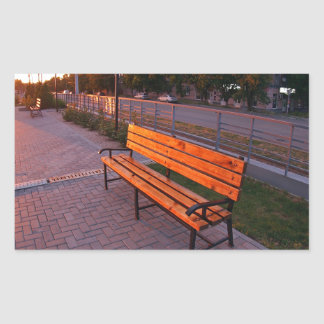 Urban cityscape with benches and lanterns in the e rectangular sticker