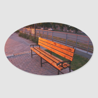 Urban cityscape with benches and lanterns in the e oval sticker