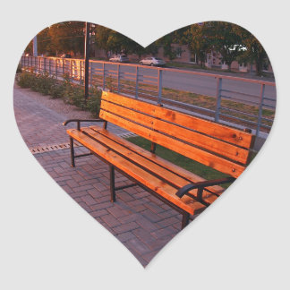 Urban cityscape with benches and lanterns in the e heart sticker