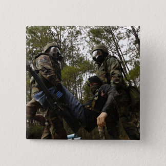 US Air Force Airmen carry a simulated casualty Button