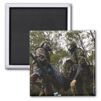 US Air Force Airmen carry a simulated casualty 2 Inch Square Magnet