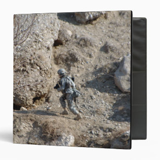US Army soldier walks up the side of a hill 3 Ring Binder