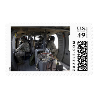 US Army soldiers watch for hazards Postage