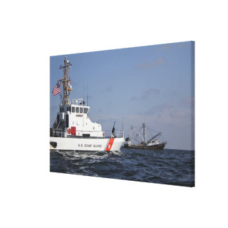 US Coast Guard Cutter Marlin patrols the waters Canvas Print