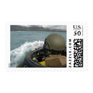 US Marine driving an amphibious assault vehicle Postage