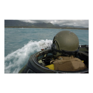 US Marine driving an amphibious assault vehicle Poster