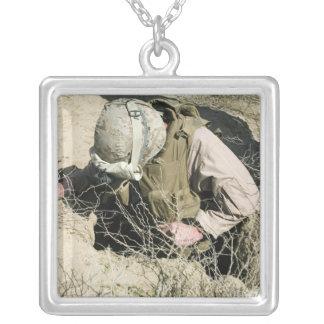 US Marine jumps down a hole Jewelry
