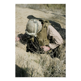US Marine jumps down a hole Posters