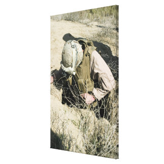 US Marine jumps down a hole Stretched Canvas Print