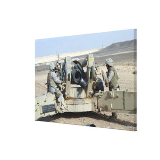 US Marines prepare to fire a howitzer Canvas Print