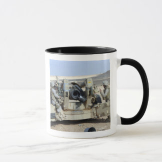 US Marines prepare to fire a howitzer Mug