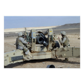 US Marines prepare to fire a howitzer Poster