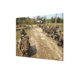 US Marines provide security as a UH-1N Canvas Print