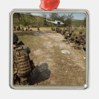 US Marines provide security as a UH-1N Metal Ornament